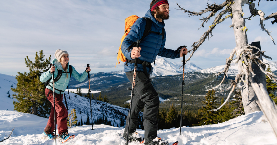 Man and woman snowshoeing during winter