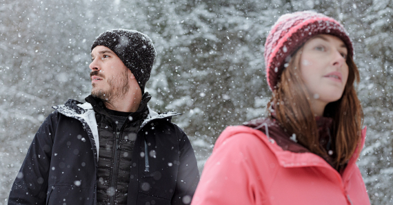 Man and woman wearing a winter jacket